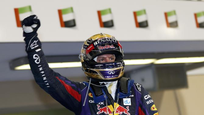 Red Bull Formula One driver Vettel of Germany celebrates after winning the Abu Dhabi F1 Grand Prix at the Yas Marina circuit on Yas Island