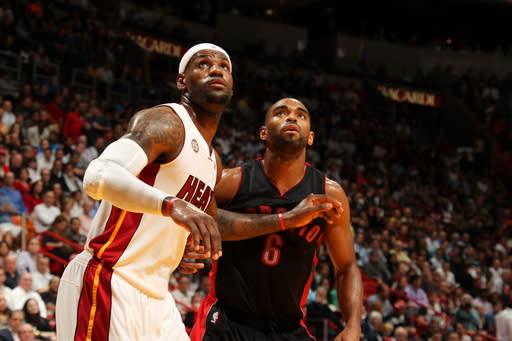 Wade, James carry Heat past Raptors in OT, 123-116