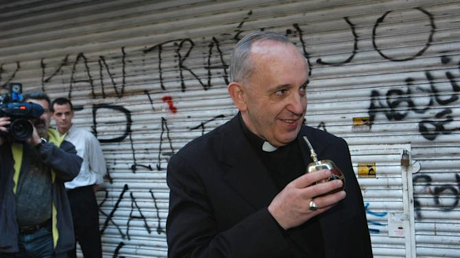 "In this picture taken March 3, 2013, Argentina's cardinal Jorge Bergoglio drinks ""mate,"" a traditional local beverage, in Buenos Aires, Argentina. Bergoglio was chosen as Pope on March 13, 2013, the first pope ever from the Americas and the first from outside Europe in more than a millennium. (AP Photo/ DyN)"