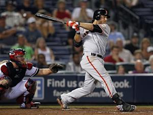 Giants score 6 runs in 11th to beat Braves 9-4