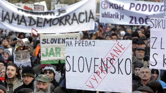 """FILE - This is a Friday, Feb. 10, 2012 file photo of demonstrators during a march against corruption in politics, in the center of Bratislava  with a banner that reads: """"For Sale – Slovakia – Sold out"""".  For two years, the dossier claims, politicians of all stripes were pocketing kickbacks from members of an influential private investment group. In the wall of the apartment where the clandestine meetings took place was a listening device planted by a secret agent intrigued by why so many high-level visitors were dropping in. The """"Gorilla"""" files _ mysteriously posted online by an anonymous source in December and said to be based on  the wiretaps _ have rocked the already-raucous world of Slovak politics ahead of elections Saturday. The fallout looks certain to propel populist former leader Robert Fico back into power, even though he himself has been implicated. (AP Photo/CTK, Jan Koller, File) SLOVAKIA OUT"""