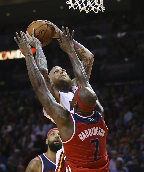 Washington Wizards' Al Harrington (7) is unable to block Miami Heat's Chris Andersen (11) during the first half of an NBA basketball game, Monday, March 10, 2014, in Miami