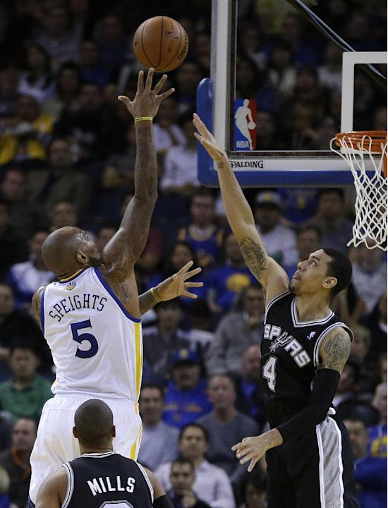Golden State Warriors' Marreese Speights, left, shoots over San Antonio Spurs' Danny Green (4) during the first half of an NBA basketball game, Thursday, Dec. 19, 2013, in Oakland, Calif