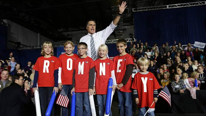 """Republican presidential candidate and former Massachusetts Gov. Mitt Romney poses with children wearing shirts which spell out """"Romney"""" as he campaigns at the Iowa Events Center, in Des Moines, Sunday, Nov. 4, 2012. (AP Photo/Charles Dharapak)"""