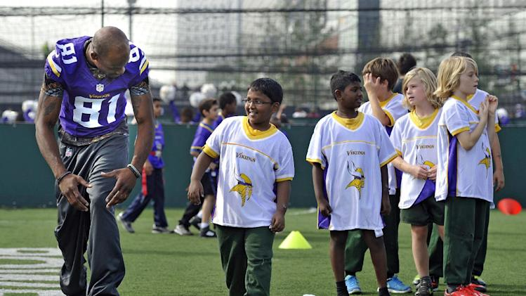 Jerome Simpson of the Vikings takes part in a coaching clinic with London children near Wembley Stadium, London, Tuesday Sept. 24, 2013. The Pittsburgh Steelers are to play the Minnesota Vikings in the NFL International Series at Wembley Stadium in London on Sunday, Sept 29