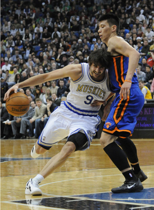 New York Knicks' Jeremy Lin, right, defends as Minnesota Timberwolves' Ricky Rubio, of Spain, drives into him in the first half of an NBA basketball game on Saturday, Feb. 11, 2012, in Minneapolis. Th