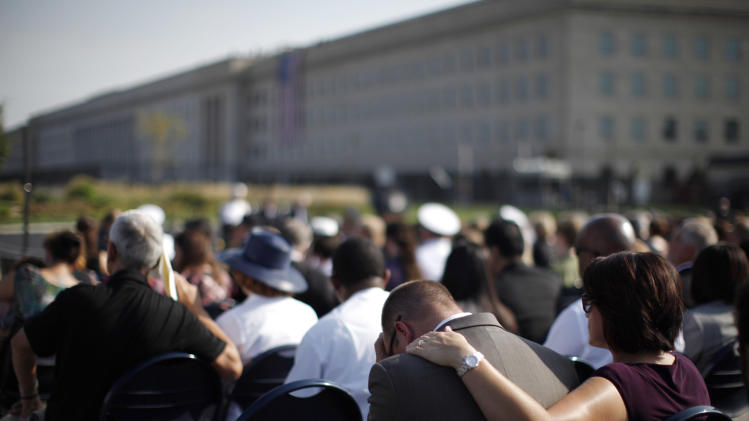 Relatives of victims of the attack on the Pentagon attend ceremonies marking the 10th anniversary of the 9/11 attack on the Pentagon in Washington