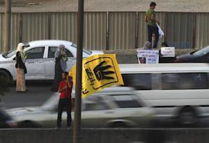 Members of the Muslim Brotherhood and supporters of ousted Egyptian President Mursi protest against the military and interior ministry at a highway south Cairo