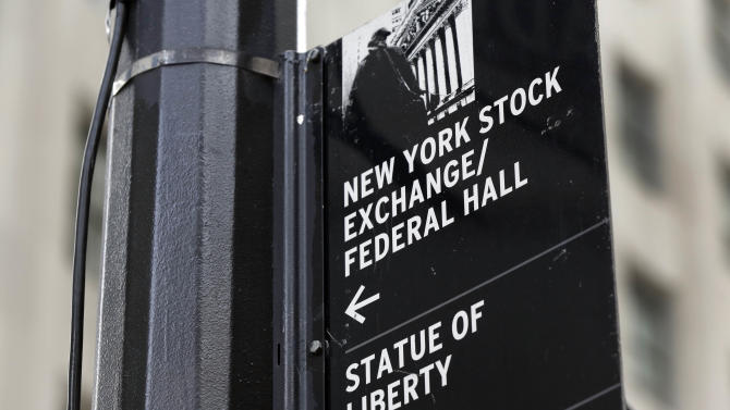 FILE - In this Oct. 2, 2014, file photo, a street sign directs people to The New York Stock Exchange, Federal Hall, and the Statue of Liberty, in New York's Financial District. Chinese stocks fell further, Tuesday, July 28, 2015, after suffering their biggest drop in eight years the previous day while most other Asian markets declined and Europe rose. (AP Photo/Richard Drew, File)