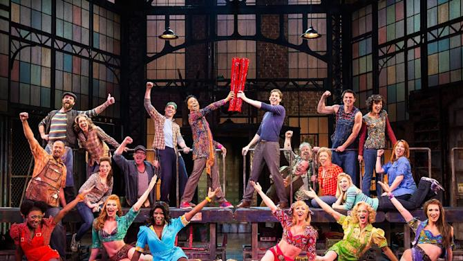 """This theater image released by The O+M Company shows the cast during a performance of the musical """"Kinky Boots.""""  The Cyndi Lauper-scored """"Kinky Boots"""" has earned a leading 13 Tony Award nominations, Tuesday, April 30, 2013. """"Kinky Boots"""" is based on the 2005 British movie about a real-life shoe factory that struggles until it finds new life in fetish footwear.  The awards will be broadcast on CBS from Radio City Music Hall on June 9. (AP Photo/The O+M Company, Matthew Murphy)"""