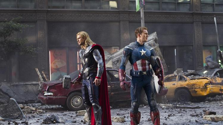 "In this film image released by Disney, Thor portrayed by Chris Hemsworth, left, and Captain America, portrayed by Chris Evans, are shown in a scene from ""The Avengers"" (AP Photo/Disney)"