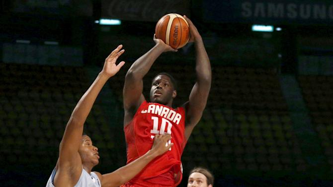 Canada's Anthony Bennett goes for the basket against Cuba's Jasiel Rivero and teammate Yaser Rodroguez, as Canada's Kelly Olynyk looks on during their 2015 FIBA Americas Championship basketball game