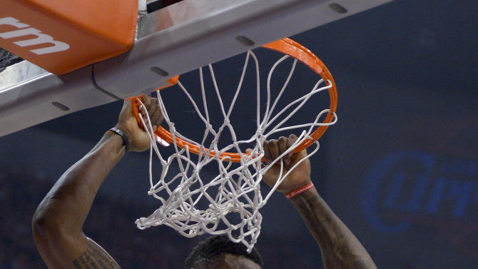 Los Angeles Clippers center DeAndre Jordan dunks against the Memphis Grizzlies during the first half of Game 2 of a first-round NBA basketball playoff series, Monday, April 22, 2013, in Los Angeles.  (AP Photo/Mark J. Terrill)