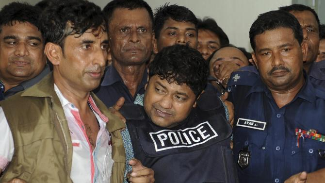 Mohammed Sohel Rana, center, the owner of a building that collapsed last week, killing at least 382 people, is brought to be produced at a court in Dhaka, Bangladesh, Monday, April 29, 2013. A Bangladesh court on Monday gave police 15 days to interrogate Rana, as rescuers used heavy machinery to cut through the destroyed structure after giving up hopes of finding any more survivors. (AP Photo)