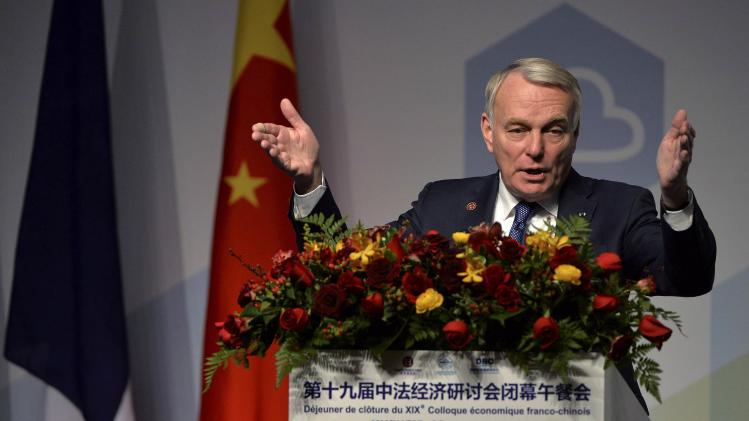 French Prime Minister Ayrault speaks at a luncheon for the annual conference of the French-Chinese committee on innovation, at the China World Hotel in Beijing