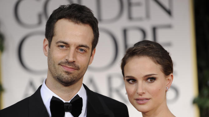 "FILE - In this Sunday Jan. 15, 2012 file photo, Benjamin Millepied, left, and Natalie Portman arrive at the 69th Annual Golden Globe Awards in Los Angeles. Benjamin Millepied, the ""Black Swan"" choreographer who helped transform Natalie Portman into an obsessed, paranoid ballerina for the film and later married the actress, was named director of the Paris Opera Ballet, Thursday, Jan. 24, 2013. (AP Photo/Chris Pizzello, File)"