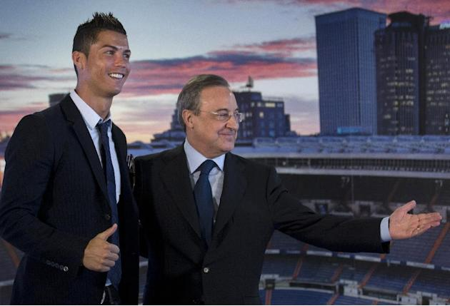 Real Madrid's Cristiano Ronaldo, left, gives the thumbs-up as club president Florentino Perez invites him to speak at the Santiago Bernabeu stadium in Madrid, Spain Sunday Sept. 15, 2013. Ronaldo has