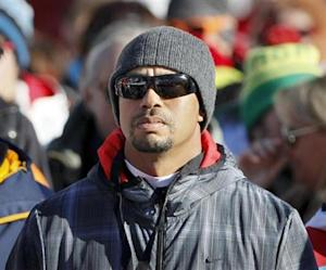 Golfer Woods of the U.S. watches the Women's World Cup Downhill skiing race in Val d'Isere