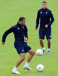 British team captain Ryan Giggs (L) and Aaron Ramsey during a team training session in England on July 9. While the response to Britain&#39;s team has been lukewarm amongst sections of the host nation&#39;s footballing press, the players involved have voiced enthusiasm for Olympic competition
