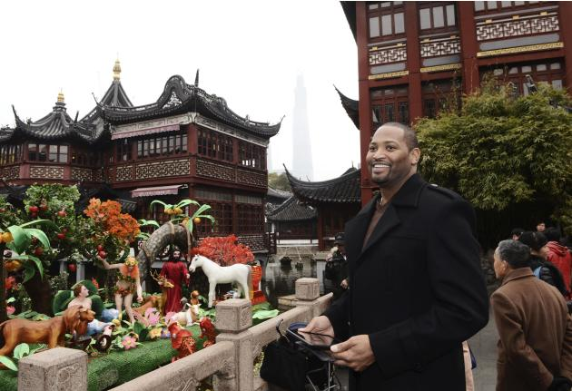 Retired NBA player and sports commentator Horry poses for pictures near the Old City God Temple in Shanghai