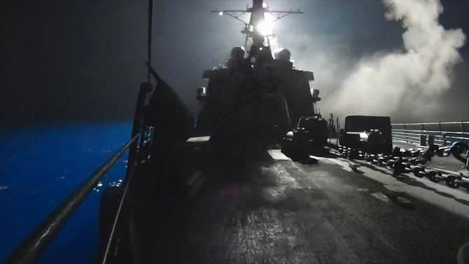 In this image made from video released by the U.S. Navy on Tuesday, Sept. 23, 2014, missiles bound for Syrian Islamic State group targets are launched off of a U.S. Navy ship. U.S. officials said the airstrikes began around 8:30 p.m. EDT (0030 GMT) Monday, and were conducted by the U.S., Bahrain, Qatar, Saudi Arabia, Jordan and the United Arab Emirates. (AP Photo/U.S. Navy via AP video)