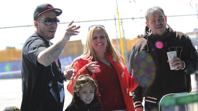 In a Saturday  March 30, 2013 photo, the Cruz family from the Bronx borough of New York play an arcade game at Eldorado Auto Skooter in New York's Coney Island.  Despite making the traditional Palm Sunday opening, many of the seasonal businesses at Coney Island are still reeling from the aftermath of Superstorm Sandy.(AP Photo/Mary Altaffer)