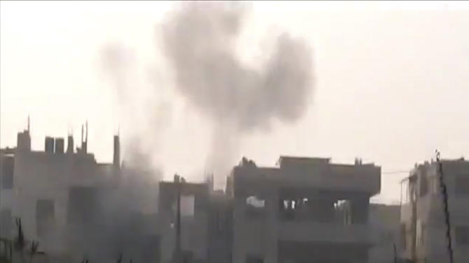 This image made from amateur video and made available by Shaam News Network Thursday Dec. 22, 2011, purports to show smoke clouds after heavy shelling in Homs, Syria. Fresh raids and gunfire by government forces on Thursday killed at least 19 people, most of them in the central city of Homs and northern Idlib province, according to the British-based Syrian Observatory for Human Rights and the Local Coordination Committees. (AP Photo/Shaam News Network via APTN) THE ASSOCIATED PRESS CANNOT INDEPENDENTLY VERIFY THE CONTENT, DATE, LOCATION OR AUTHENTICITY OF THIS MATERIAL.  TV OUT