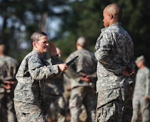 In this US Army photo, Army Capt. Kristen Griest (L) …