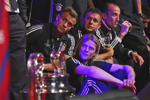 Bayern's Xherdan Shaqiri of Switzerland, Anatoliy Tymoshchuk, Rafinha and Tom Starke, from left, attend the Bayern Munich Champions League Finale banquet at Grosvenor House on Saturday, May 25, 2013 a