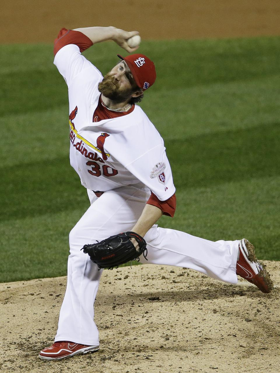 St. Louis Cardinals relief pitcher Jason Motte (30) works during the ninth inning of Game 3 of baseball's National League championship series against the San Francisco Giants, Wednesday, Oct. 17, 2012, in St. Louis. The Cardinals won 3-1. (AP Photo/Patrick Semansky)