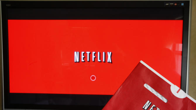 FILE - In this Oct. 1, 2011 file photo, a Netflix DVD envelope and Netflix on-screen television menu are shown in Surfside, Fla. Netflix is going to start running original television series from Dreamworks Animation, the company announced Monday, June 17, 2013. Financial terms were not disclosed. Netflix Inc. says the multi-year agreement is its biggest deal ever for original first-run content and includes more than 300 hours of new programming. It expands on an existing relationship between the companies. (AP Photo/Wilfredo Lee, File)