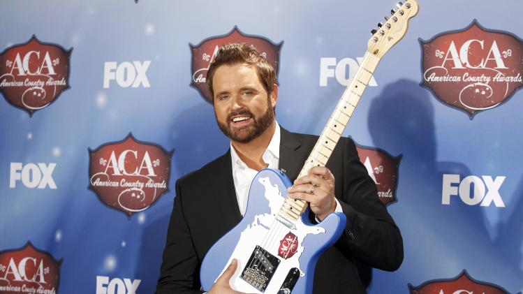 Houser poses with his most played track by a male artist award during the 4th annual American Country Awards in Las Vegas