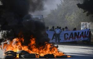 Residents burn tires at a blockade on the Pan-American …