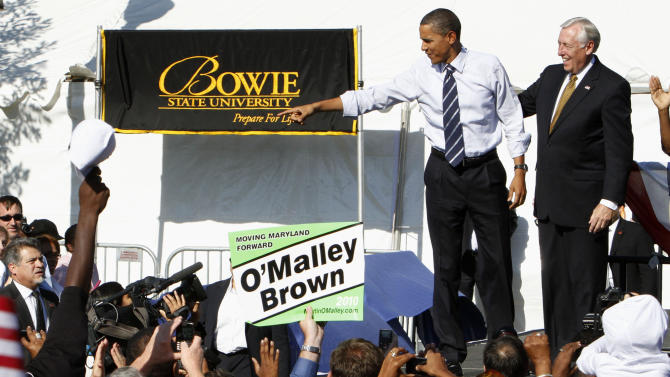 FILE - In this Oct. 7, 2010, file photo, President Barack Obama waves to the crowd with House Majority Leader Steny Hoyer, D-Md., at a re-election campaign stop for Maryland Gov. Martin O'Malley, at Bowie State University in Bowie, Md. Despite polls indicating many minority voters are discouraged and won't turn out Nov. 2 like they did for Obama two years ago, a solid showing among blacks could still swing several House, Senate and gubernatorial races, according to some analysts. (AP Photo/Jacquelyn Martin, File)