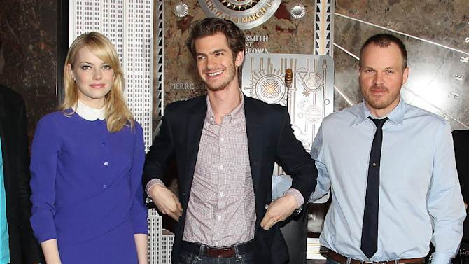 "This Monday, June 25, 2012 file image released by Starpix shows actors  Emma Stone, left, and Andrew Garfield with director Marc Webb from ""The Amazing Spider-Man,"" at the Empire State Building during a lighting ceremony in New York. Stone, Garfield and Webb replace Kirsten Dunst, Tobey Maguire and director Sam Raimi from the previous films in the hugely popular Spider-man franchise. ""The Amazing Spider-Man"" opens nationwide on July 3. (AP Photo/Starpix, Amanda Schwab)"