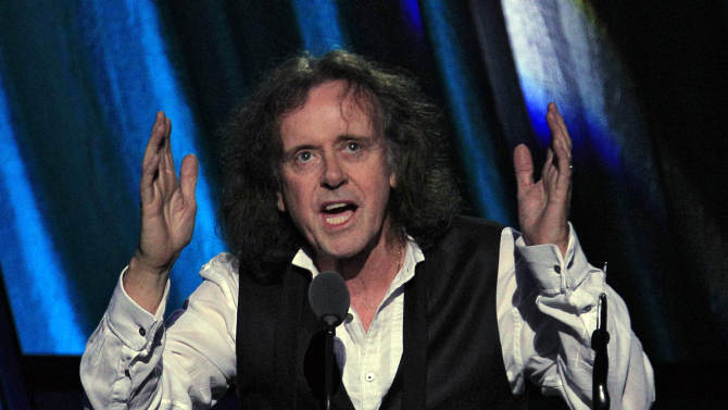 Donovan Leitch accepts induction into the Rock and Roll Hall of Fame Saturday, April 14, 2012, in Cleveland. (AP Photo/Tony Dejak)