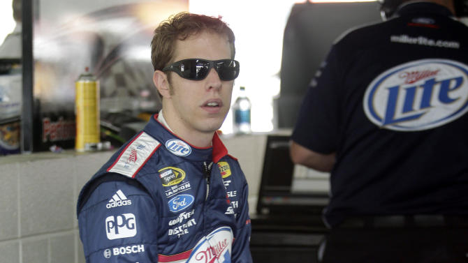 Brad Keselowski waits by his car before practice for Sunday's NASCAR Sprint Cup series Coca-Cola 600 auto race at Charlotte Motor Speedway in Concord, N.C., Thursday, May 23, 2013. (AP Photo/Nell Redmond)