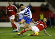 Nottingham Forest's Henri Lansbury and Reading's Hal Robson-Kanu (left)