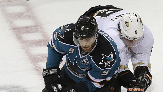 San Jose Sharks left wing Martin Havlat, left, and Anaheim Ducks right wing Bobby Ryan reach for the puck during the first period of an NHL hockey game in San Jose, Calif., Tuesday, Jan. 29, 2013. (AP Photo/Jeff Chiu)