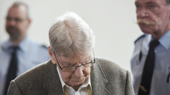 Reinhold H., a 94-year-old former guard at Auschwitz arrives to the courtroom for his trial in Detmold