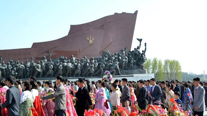 KCNA picture shows people visiting the statues of former North Korean leaders Kim Il Sung and Kim Jong Il on the 83rd founding anniversary of the Korean People's Army, in Pyongyang