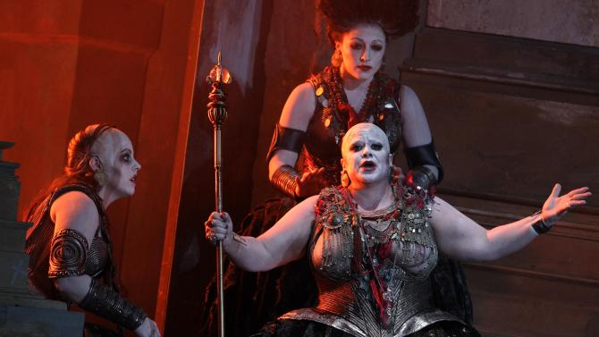 """In this photo taken Tuesday, Oct. 2, 2012, in Chicago, Emily Birsan as Trainbearer, left, Jill Grove as Klyamnestra, with sceptor, and Kiri Deonarine as Confidante, top right, perform during the first act of a dress rehearsal of the Lyric Opera of Chicago's new production of """"Elektra."""" (AP Photo/M. Spencer Green)"""