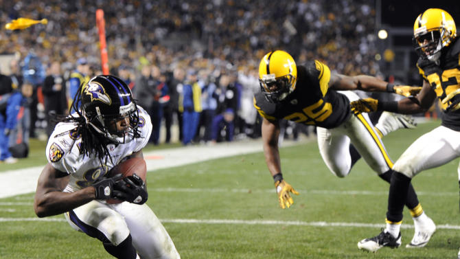Baltimore Ravens wide receiver Torrey Smith, left, makes a catch for a touchdown after getting past Pittsburgh Steelers cornerback William Gay (22) and safety Ryan Clark (25) with 8 seconds left in the fourth quarter to beat the Steelers 23-20 in an NFL football game, Sunday, Nov. 6, 2011, in Pittsburgh. (AP Photo/Don Wright)