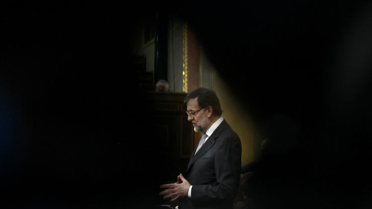 Spain's Prime Minister Mariano Rajoy speaks during a state of the nation debate at the Spanish Parliament in Madrid, Spain, Wednesday, Feb. 20, 2013. (AP Photo/Andres Kudacki)