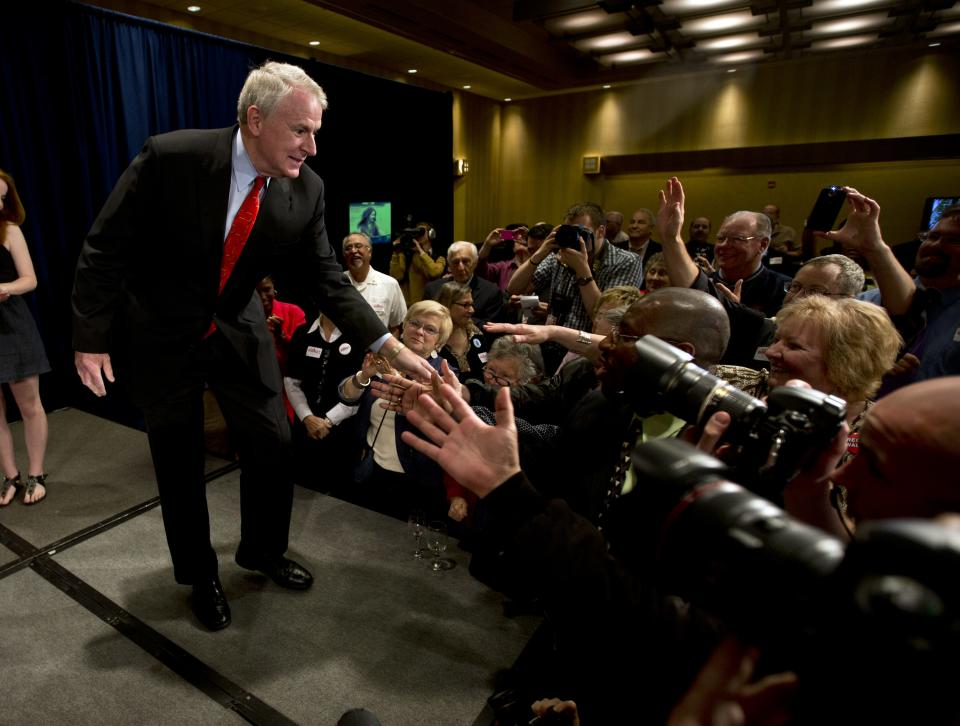 Wisconsin Democratic gubernatorial candidate, Milwaukee Mayor Tom Barrett, shakes hands with supporters before speaking at his primary election victory party Tuesday, May 8, 2012, in Milwaukee. Democrats overwhelmingly picked Barrett to challenge Republican Wisconsin Gov. Scott Walker in a June recall election. (AP Photo/Morry Gash)