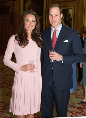 Kate wears a bubble-gum pink dress while attending the Queen's Diamond Jubilee lunch for sovereign monarch in May. Kate really seems to love pleated skirts and long sleeves.