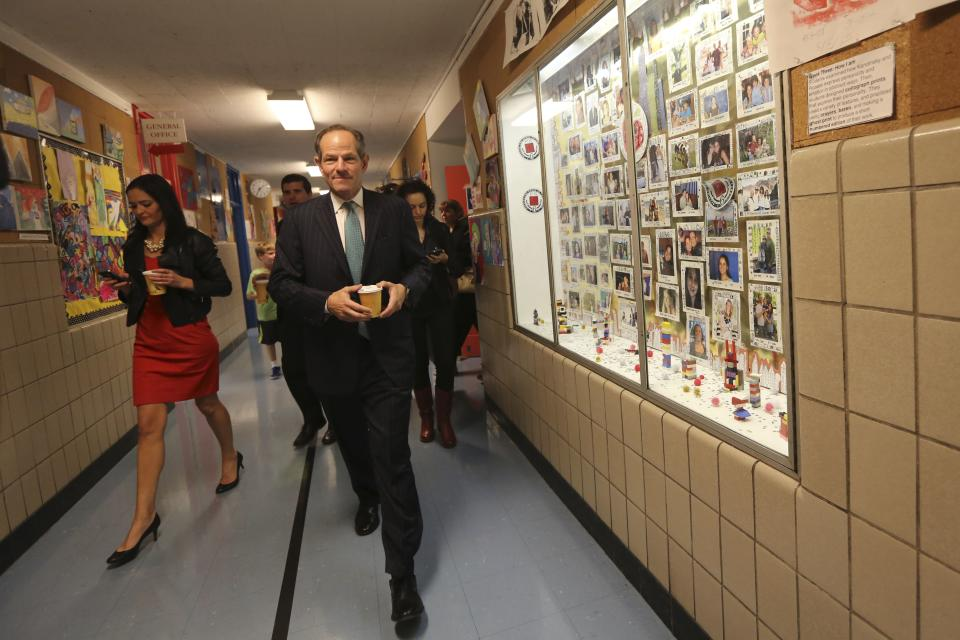 Democratic comptroller hopeful Eliot Spitzer leaves his polling station after voting in the primary election in New York, Tuesday, Sept. 10, 2013. (AP Photo/Mary Altaffer)