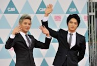 Members of South Korean boyband JYJ Jae-Joong (R) and Jun-Su are seen during a launch event for their exhibition in Seoul, on June 28. JYJ invited 7,000 Japanese and 15,000 Korean fans to the event in Seoul, featuring performance costumes, trophies, film footage, pictures and favourite items of each member