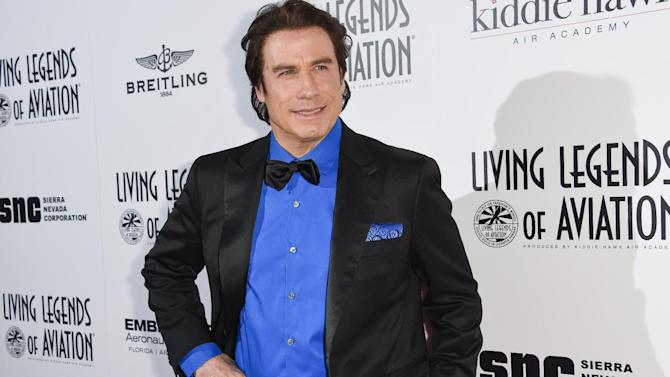 FILE - In this Jan. 16, 2015 file photo, John Travolta attends the 12th Annual Living Legends of Aviation Awards at The Beverly Hilton Hotel in Los Angeles. Chatter crops up online when 61-year-old Travolta makes a public appearance with a solid block of mahogany hair on top of his head and incongruous salt-and-pepper sideburns peeking out underneath. But celebrity fashion stylist Felix Mercado says it's the unflattering look that causes a stir, not the fact that Travolta, or anyone else his age, colors their hair. (Photo by Rob Latour/Invision/AP, File)