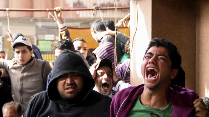 Families and supporters of those accused of soccer violence from the Port Said soccer club react to the announcement of verdicts for 21 fans on trial in last years Port Said stadium incident which left 74 people dead, in Port Said, Egypt, Saturday, Jan. 26, 2013. Egyptian security officials say at least 8 people have died in the Mediterranean city of Port Said after a judge sentenced 21 people to death in connection to one of the world's deadliest incidents of soccer violence. (AP Photo/Mohammed Nouhan, Shorouk Newspaper)   EGYPT OUT